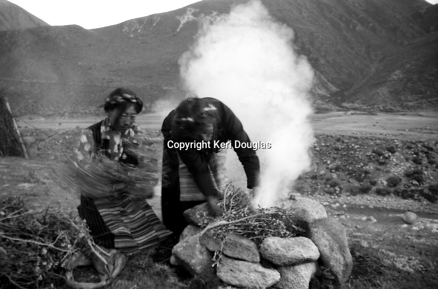 The early morning the prayer is done while burning dry sage like twigs. Drikung (Drigung) Valley, Tibet.