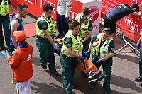 Quinton Fortune<br /> carried away by St John's Ambulance at the finish line on The Mall at the 2017 London Marathon, London. <br /> <br /> <br /> &copy;Ash Knotek  D3254  23/04/2017