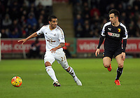 (L-R) Kyle Naughton of Swansea against Jose Manuel Jurado of Watford during the Barclays Premier League match between Swansea City and Watford at the Liberty Stadium, Swansea on January 18 2016
