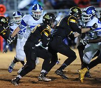 NWA Democrat-Gazette/ANDY SHUPE<br /> Kyle Sam (35) of Prairie Grove carries the ball through the Star City defense Friday, Nov. 27, 2015, during the first half of play at Tiger Stadium in Prairie Grove. Visit nwadg.com/photos to see more photographs from the game.