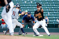 June 21, 2009:  Rochester Red Wings First Baseman Brock Peterson takes a pick off attempt throw from Kevin Mulvey as Scott Sizemore gets back to first during a game at Frontier Field in Rochester, NY.  The Rochester Red Wings are the International League Triple-A affiliate of the Minnesota Twins.  Photo by:  Mike Janes/Four Seam Images