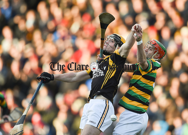 Niall Deasy of Ballyea in action against Steven Mc Donnell of Glen Rovers during their Munster Club hurling final at Thurles. Photograph by John Kelly.
