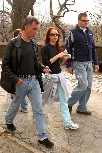 WWW.ACEPIXS.COM . . . . .  ....NEW YORK, MARCH 30, 2005....Lindsay Lohan on the set of 'Just My Luck' filming in Central Park. Lindsay even takes a moment to videotape our photographer.....Please byline: PAUL CUNNINGHAM - ACE PICTURES..... *** ***..Ace Pictures, Inc:  ..Craig Ashby (212) 243-8787..e-mail: picturedesk@acepixs.com..web: http://www.acepixs.com