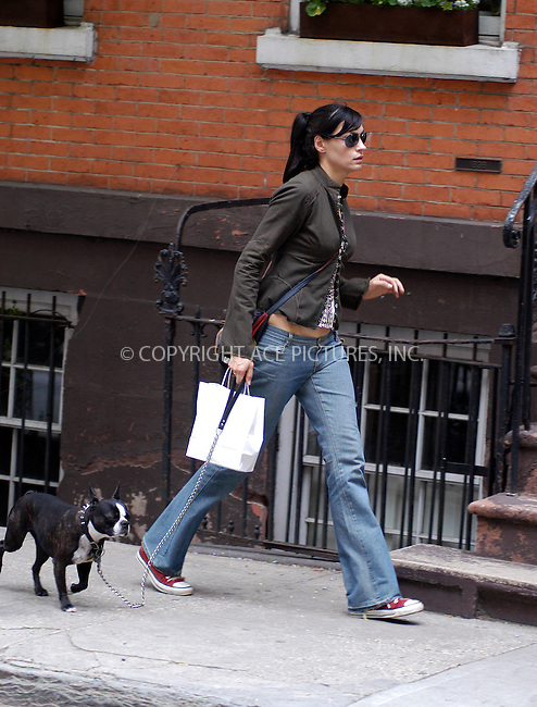 """X-Men"" star Famke Jensen spotted walking her dog in West Village. New York, May 14, 2003. Please byline: NY Photo Press.   ..*PAY-PER-USE*      ....NY Photo Press:  ..phone (646) 267-6913;   ..e-mail: info@nyphotopress.com"