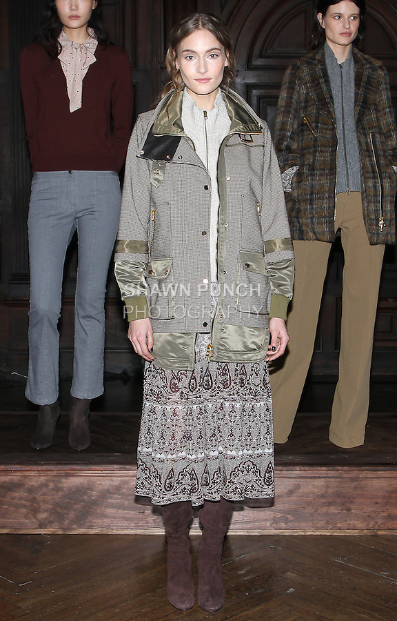 "Model Anushka poses in a blush Gypsy Batik chiffon boho dress and oatmeal chunk cable knit dickey, from the Veronica Beard Fall 2016 ""Gypsy Caravan"" collection presentation, at the Highline Hotel on February 15 2016, during New York Fashion Week Fall 2016."