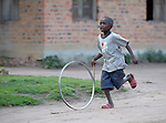 A boy plays in the Congolese village of Wembo Nyama..