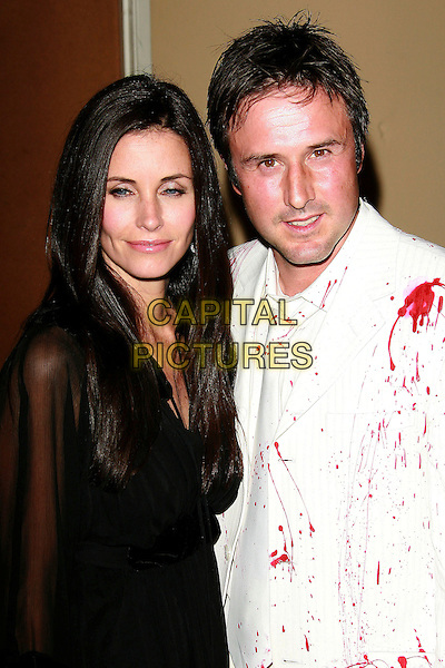 "COURTENEY COX ARQUETTE & DAVID ARQUETTE.""The Tripper"" Los Angeles Premiere - Arrivals held at Mann's Chinese Theatre, Hollywood, California, LA, USA,.13th October 2006..half length black dress sheer see through sleeves white suit red paint blood splattered pattern married couple husband wife courtney.Ref: ADM/ZL.www.capitalpictures.com.sales@capitalpictures.com.©Zach Lipp/AdMedia/Capital Pictures."