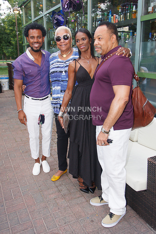 "Fashion designer Edwing D'Angelo (far left) posing with guests at his Edwing D'Angelo Spring Summer 2019 ""Pristine"" collection fashion show at Sofrito in New York City on July 11, 2018; during New York Fashion Week: Men's Spring Summer 2019."