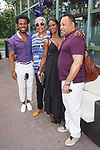 """Fashion designer Edwing D'Angelo (far left) posing with guests at his Edwing D'Angelo Spring Summer 2019 """"Pristine"""" collection fashion show at Sofrito in New York City on July 11, 2018; during New York Fashion Week: Men's Spring Summer 2019."""