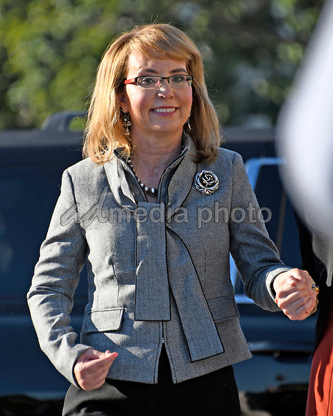 Former United States Representative Gabrielle Giffords (Democrat of Arizona) arrives as US House Democrats appear on the East Steps of the US Capitol to make a statement against gun violence in the wake of the Las Vegas Massacre in Washington, DC on Wednesday, October 4, 2017. Photo Credit: Ron Sachs/CNP/AdMedia