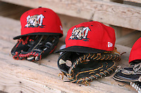 August 2, 2009:  Muckdogs hats and gloves site on the dugout bench during a game at Dwyer Stadium in Batavia, NY.  The Muckdogs are the Short-Season Class-A affiliate of the St. Louis Cardinals.  Photo By Mike Janes/Four Seam Images