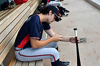 Pitcher Ian Anderson (19) of the Rome Braves painstakingly tapes the bat handle for catcher Carlos Martinez (not pictured) during game one of a doubleheader against the Columbia Fireflies on Saturday, August 19, 2017, at Spirit Communications Park in Columbia, South Carolina. Rome won, 8-2. (Tom Priddy/Four Seam Images)
