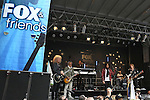 "NEW YORK, NY - JUNE 14: Bruce Watson, Mick Jones, Kelly Hansen, Jeff Pilson and Thom Gimbel of Foreigner performs at ""FOX & Friends"" All American Concert Series outside of FOX Studios on June 14, 2013 in New York City.  (Photo by Walter McBride/FilmMagic)"