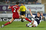Charlie Mulgrew and Scott Arfield in a committed tackle