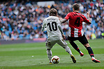 Real Madrid's Luka Modric and Athletic Club de Bilbao's Inigo Martinez during La Liga match between Real Madrid and Athletic Club de Bilbao at Santiago Bernabeu Stadium in Madrid, Spain. April 21, 2019. (ALTERPHOTOS/A. Perez Meca)