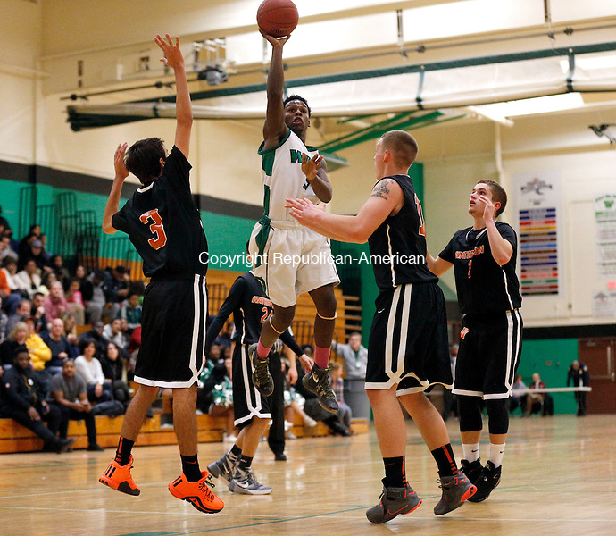 Waterbury, CT- 07 January 2016-010716CM09- Wilby's Darrien Bell takes a jump shot against Watertown's Vailonis (3) and Zach Kopp during their NVL matchup in Waterbury on Thursday.     Christopher Massa Republican-American