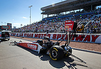 Mar 30, 2014; Las Vegas, NV, USA; NHRA top fuel driver Steve Torrence being towed on the return road in front of the packed grandstands during the Summitracing.com Nationals at The Strip at Las Vegas Motor Speedway. Mandatory Credit: Mark J. Rebilas-