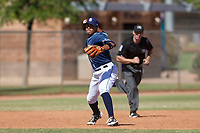 San Diego Padres third baseman Kelvin Melean (4) makes a throw to first base during an Instructional League game against the Milwaukee Brewers on September 27, 2017 at Peoria Sports Complex in Peoria, Arizona. (Zachary Lucy/Four Seam Images)