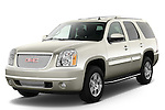 Front three quarter view of a 2012 GMC Yukon Denali suv