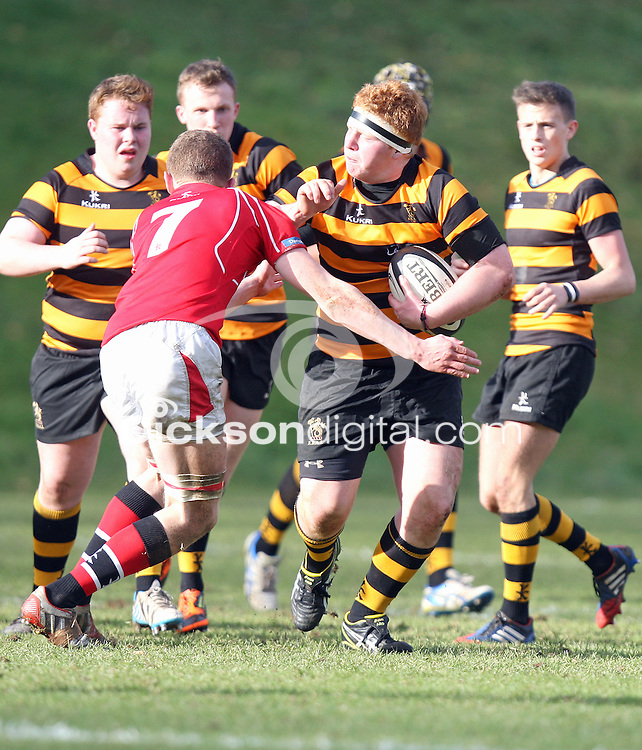 SCHOOLS CUP 2015  | Saturday 7th February 2015<br /> <br /> John Dickson fends off Conn Crawford during the third round of the 2015 Ulster Schools Cup between RBAI and Regent House at Osborne Park, Belfast.<br /> <br /> Picture credit: John Dickson / DICKSONDIGITAL