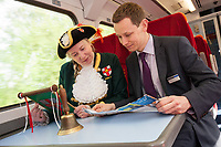 Lincoln Town Crier Karen Crow proclaims the launch of the new Lincoln to Nottingham timetable with East Midlands Train's Lawrence Bowman