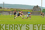 St Michaels/Foilmore's Damien Kelly over shoots and Austin Stacks John Dennis stretches.