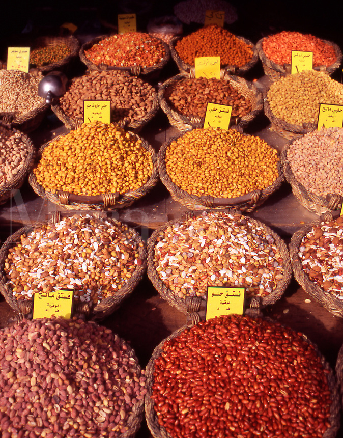 Baskets of nuts, spices, cereal, and lentils in a shop in downtown Amman, Jordan, The Middle East.