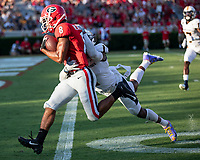 ATHENS, GA - SEPTEMBER 7: Dominick Blaylock #8 runs for a touchdown with T.J. Warren #1 trying to tackle him during a game between Murray State Racers and University of Georgia Bulldogs at Sanford Stadium on September 7, 2019 in Athens, Georgia.