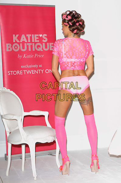 Katie Price (Jordan) .The launch photocall for Katie Price's new summer lingerie range for Store 21, The Worx, London, England..May 29th, 2012.full length pink lace top knickers underwear tights stockings tattoo garter beige platform sandals shoes rollers curlers in hair back behind rear.CAP/ROS.©Steve Ross/Capital Pictures.