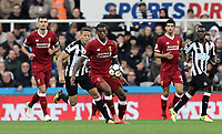 Liverpool's Georginio Wijnaldum controls under pressure from Newcastle United's Dwight Gayle<br /> <br /> Photographer Rich Linley/CameraSport<br /> <br /> The Premier League -  Newcastle United v Liverpool - Sunday 1st October 2017 - St James' Park - Newcastle<br /> <br /> World Copyright &copy; 2017 CameraSport. All rights reserved. 43 Linden Ave. Countesthorpe. Leicester. England. LE8 5PG - Tel: +44 (0) 116 277 4147 - admin@camerasport.com - www.camerasport.com
