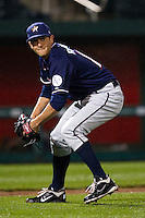Heath Rollins (17) of the Northwest Arkansas Naturals fields a bunted ball during a game against the Springfield Cardinals on May 13, 2011 at Hammons Field in Springfield, Missouri.  Photo By David Welker/Four Seam Images.