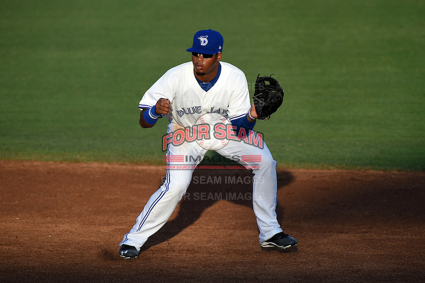 Dunedin Blue Jays shortstop Dawel Lugo (31) fields a ground ball during a game against the Bradenton Marauders on April 14, 2015 at Florida Auto Exchange Stadium in Dunedin, Florida.  Bradenton defeated Dunedin 7-1.  (Mike Janes/Four Seam Images)