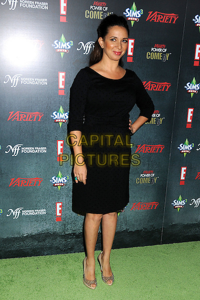 Maya Rudolph.Variety's 2nd Annual Power of Comedy Event held at the Hollywood Palladium, Hollywood, California, USA, .19th November 2011..full length black dress hand on hip  peep toe beige shoes .CAP/ADM/BP.©Byron Purvis/AdMedia/Capital Pictures.