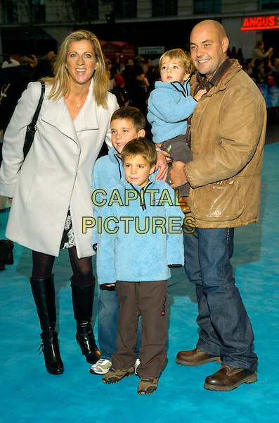 "SALLY GUNNELL & FAMILY.Attends the European Film Premiere of ""Happy Feet"" .Empire Cinema, leicester Square, London, England,.November 26th 2006..full length black leather knee high boots grey white coat kids boys children.CAP/CAN.©Can Nguyen/Capital Pictures"