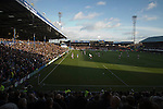 "Portsmouth 1 Southampton 1, 18/12/2012. Fratton Park, Championship. A near-capacity crowd watching the action as Portsmouth take on visitors Southampton during the second half of their Championship fixture at Fratton Park stadium, Portsmouth. Around 3000 away fans were taken directly to the game in a fleet of buses in a police operation known as the ""coach bubble"" to avoid the possibility of disorder between rival fans. The match ended in a one-all draw watched by a near capacity crowd of 19,879. Photo by Colin McPherson."