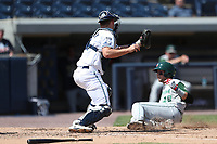 West Michigan Michigan Whitecaps catcher Drew Longley (14) prepares to tag Fort Wayne TinCaps baserunner Hudson Potts (20) at the plate during the Midwest League baseball game on April 26, 2017 at Fifth Third Ballpark in Comstock Park, Michigan. West Michigan defeated Fort Wayne 8-2. (Andrew Woolley/Four Seam Images)