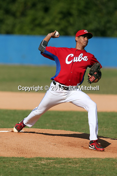 Roy Hernandez works out at the Dominican Republic air force base in front of 100+ Major League Baseball scouts prior to being declared eligible to sign since defecting from his native Cuba in Santo Domingo, Dominican Republic on February 11, 2015 (Bill Mitchell)