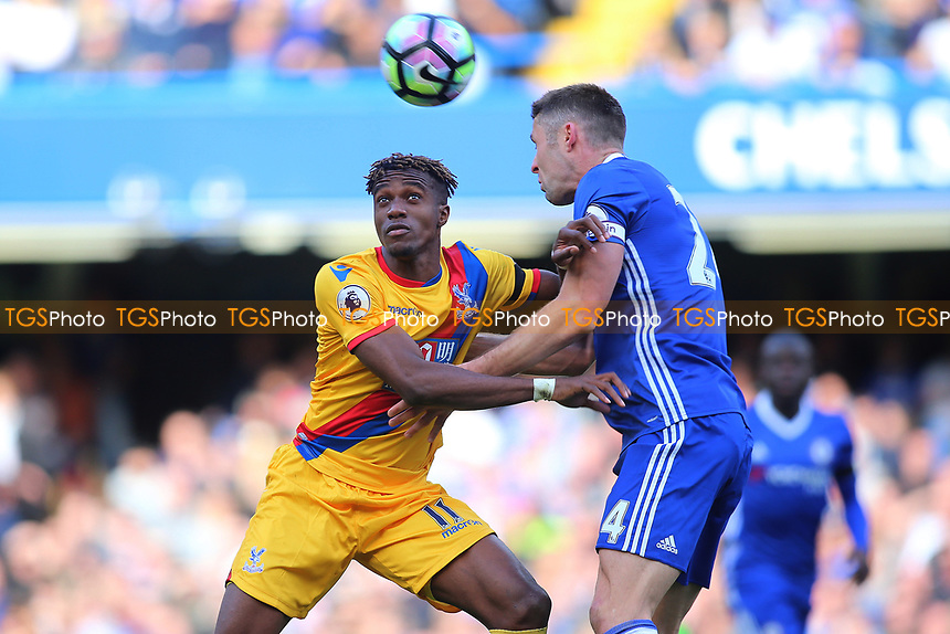 Wilfried Zaha of Crystal Palace and Gary Cahill of Chelsea during Chelsea vs Crystal Palace, Premier League Football at Stamford Bridge on 1st April 2017