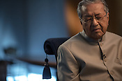 Tun Mahathir Mohamad, Malaysia's former prime minister, reacts during an interview in his office in the iconic Petronas Twin Towers in Kuala Lumpur, Malaysia, on Thursday, Feb. 25, 2016.