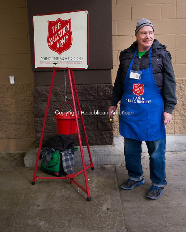 Waterbury, CT- 09 December 2015-120915CM07- Scott Ritchie, a kettle worker with the Salvation Army, rings a bell outside Walmart in Waterbury on Wednesday   Ritchie was collected donations for the Salvation Army, which provides to those in need, among other charitable efforts. Christopher Massa Republican-American