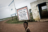 A child outside the Posco India transit camp in Badagabapur. The camp has been set up for people who have been driven out of their villages for being pro-Posco. They live on the side of a highway on USD 80 a day shared between 195 people. South Korean steel giant Posco continues to face stiff public resistance in Orissa's Jagatsinghpur district where the company is setting up India's biggest direct foreign investment project of a 12 million tonne steel plant, at the cost of USD 12 Billion.