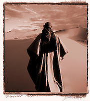 Concept illustration of nomadic male figure wandering alone in the desert.