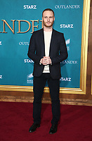 "HOLLYWOOD, CA - FEBRUARY 13: Yan Tual, at the Premiere Of Starz's ""Outlander"" Season 5 at HHollywood Palladium in Hollywood California on February 13, 2020. Credit: Faye Sadou/MediaPunch"