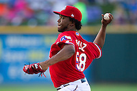 Texas Rangers pitcher Neftali Feliz #58 delivers during a rehab start with the Pacific Coast League Round Rock Express. Feliz pitched 1.2 innings against Omaha Storm Chasers on July 20, 2012 at the Dell Diamond in Round Rock, Texas. The Chasers defeated the Express 10-4. (Andrew Woolley/Four Seam Images).
