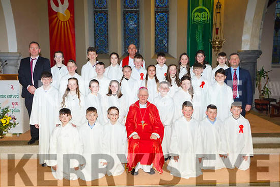 Holy Family NS pupils with Bishop Ray Browne, Fr Pat O'Donnell, and Paul Horan Principal and Paudie Dineen teacher at their Confirmation in St Josephs church Rathmore on Tuesday