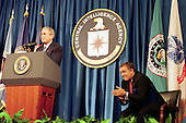 United States President George W. Bush speaks at the Central Intelligence Agency's headquarters in Langley, Virginia as CIA director George Tenet(R) applauds on September 26, 2001. U.S. Senate Intelligence Committee Vice Chairman Richard Shelby questioned the Tenet's competence in the wake of the September 11 attacks on New York and Washington. Bush voiced confidence in Tenet's abilities. 'I've got a lot of confidence in him and I've got a lot of confidence in the CIA. And so should America,' Bush told CIA employees, in his first visit to the spy agency's headquarters since the attacks..Credit: Martin Simon / Pool via CNP