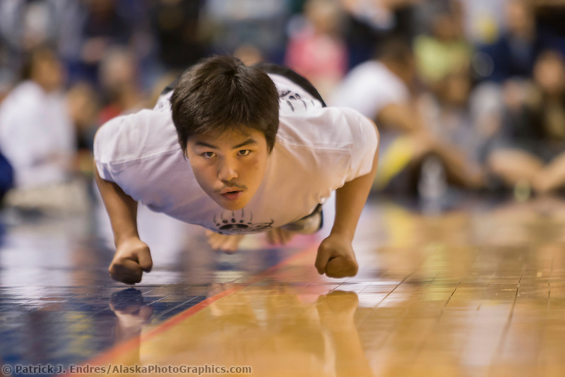 "Knuckle hop or seal hop competition at the 2008 World Eskimo Indian Olympics, Fairbanks, Alaska. A game of endurance, pain and strength. The object is to see how far one can go in a ""push-up"" hopping position, with elbows bent and knuckles down."