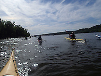 Paddlers head down the Mississippi River near Dubuque, Iowa.