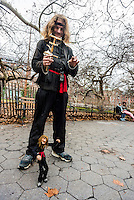 New York, NY 25 December 2015 Larry the Birdman with his own puppet which fashioned after him by Rickt Syers.