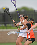 O'Fallon's Alexa Prouhet (left) passes as she's pressured by Minooka's Victoria Cook. O'Fallon played Minooka in a quarterfinal game of the O'Fallon sectional at O'Fallon Sports Park on Monday May 20, 2019. <br /> Tim Vizer/Special to STLhighschoolsports.com